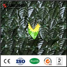 China Outdoor Artificial Palm Leaves Plant Privacy Wall Fence Cover China Fence Artificial Plant