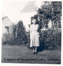 PO.574.0104.2 - Woman in yard in North Bend, possibly Addie Anderson.