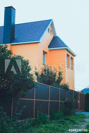 A Beautiful Country House The Walls Are Decorated With Beige Decorative Plaster A High Fence With A Gate The Concept Of The Design Of A Modern Country House Buy This Stock