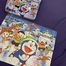 Shop Doraemon - Hanoi mưa gió ngoiif xếp hình ???