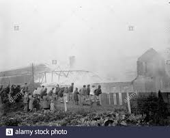 Children Climb On A Fence To Watch The Fire At The Vickers Factory In Crayford Kent 1936 Stock Photo Alamy