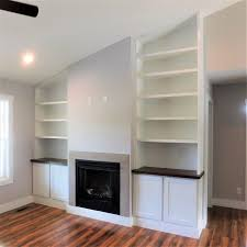 built in shelving around fireplace
