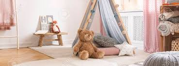 Cute Teddy Bear In Pink And Blue Colored Kids Room In Stylish Stock Photo Picture And Royalty Free Image Image 127522056