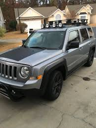 2016 Jeep Patriot With 3 Inch Pull Bar Hood Decal Painted Black Fender Flares And Wheels Roof Fog Lights Jeep Patriot Jeep Patriot Accessories Lifted Jeep