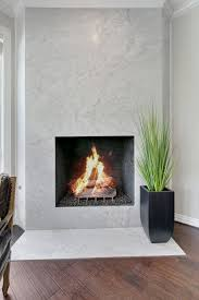 floor to ceiling marble slab fireplace