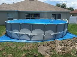 Blocks Repeat Around The Low Side Of The Pool Add And Pack Earth Under Where You In 2020 Installing Above Ground Pool Above Ground Pool Landscaping Pool Installation