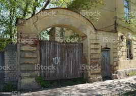 Old Brick Fence With Wooden Gate Quiet Street With Old Houses In A Small Russian Town Stock Photo Download Image Now Istock