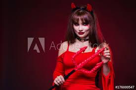 a beautiful woman in a devil costume