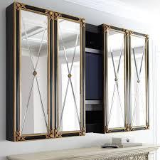 hide tvs behind hinged or sliding doors