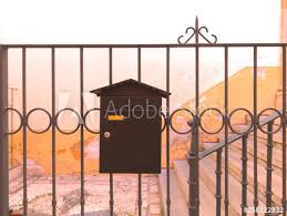 Metallic Brown Vintage Mailbox Attached To A Wrought Iron Brown Entrance Gate Buy This Stock Photo And Explore Similar Images At Adobe Stock Adobe Stock