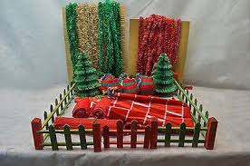Old Box Of Christmas Decorations Wood Fence Paper Evergreen Trees Bulbs Etc 1692330168