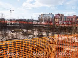 Construction Site Of Residential Building Behind The Red Safety Fence In The Sunny Day Stock Photo Download Image Now Istock