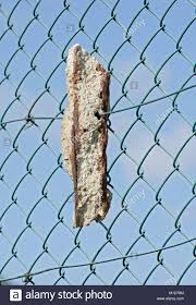 Crumbling Concrete Post Being Supported By Chain Link Fence It Was Stock Photo Alamy