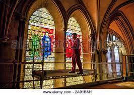 glass conservator sam kelly inspects