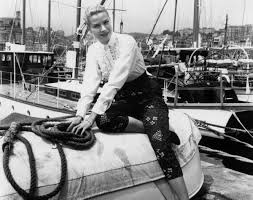 Grace Kelly Posing Harborside at the Cannes film festival (1955)