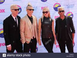 NO DOUBT US rock group from left: Tom Dumont (guitar), Adrian ...