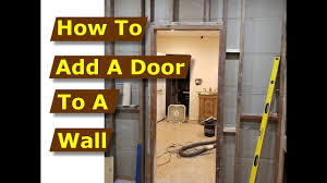 how to add door frame in wall after