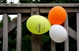 Yellow Orange And White Balloon Beside Gray Wooden Fence Free Stock Photo