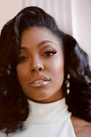 """Porsha Williams of """"Real Housewives of Atlanta"""" Shows Us Her Wig Room 