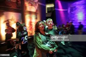 Byron Ryan and Pilar Ybarra walk through the strobe-light lit... News Photo  - Getty Images