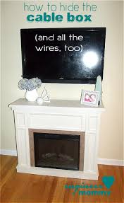 hide cable box tv over fireplace