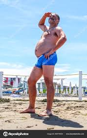 pictures funny beach fat man beach