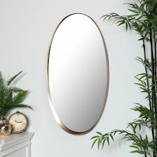large oval copper framed wall mirror