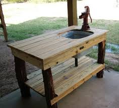 outdoor kitchen table with sink fed by