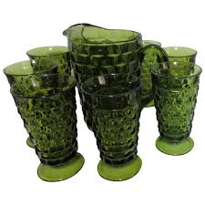 green pitcher and 8 iced tea glasses