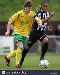 Greg Lincoln of Thurrock (left) takes on Wesley Thomas of Fisher ...