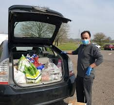 Ola Drivers Volunteering to Distribute Food Supplies - The Active Wellbeing  Society