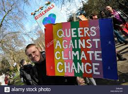 Gay protesters participating in a demonstration against climate ...