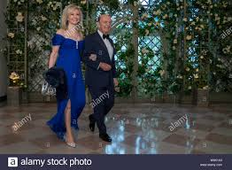 Wilbur L. Ross, Junior, Secretary of Commerce and Mrs. Hilary Ross arrive  for the State dinner in honor of French President Emmanuel Macron and his  wife Brigitte at the White House in