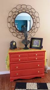 This orange dresser greets my guests in my entry. Wendi Moore ...