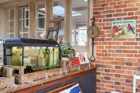 Chic Little Tikes Castle In Spaces Farmhouse With Brick Wall Mortar Next To Old Fence Boards Alongside Stone And Hardie Board And Between The Studs Storage