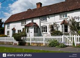 White Picket Fence English House High Resolution Stock Photography And Images Alamy