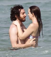 Leighton Meester shows off her pert derriere as she frolics in sea ...