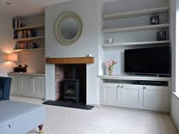 shelving either side of fire place