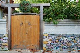 Asian Style Wood Doors With Redwood Fence And Multi Color Stone Stock Photo Picture And Royalty Free Image Image 8488897
