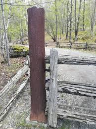 A Fence Post Looking Like A Tree Trunk Welding