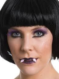 purple lipstick eye lashes fangs