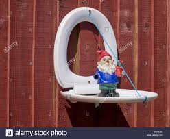 A White Plastic Toilet Seat Reused As A Garden Ornament Fixed To A Stock Photo Alamy