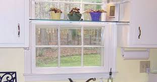 diy glass shelves in front of kitchen