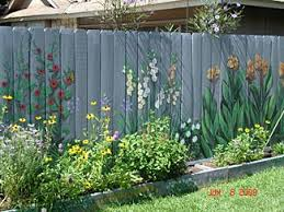 I Want To Paint The Fence I Can T Seem To Keep Flowers Alive So I Thought This Was A Good Idea My Husband Said They Woul Garden Mural Fence Art Fence Paint