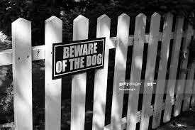 Beware Of Dog Sign On White Picket Fence High Res Stock Photo Getty Images