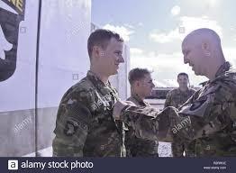 U.S. Army Lt. Col. John R. Gunter, Task Force Shadow commander, pins the  rank of captain on 1st Lt. Wesley Johnston and 1st Lt. Taylor Rammrath on  Bagram Airfield, Afghanistan Nov. 1,