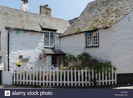 A Quaint Whitewashed Cottage With A Small Garden Bounded By A White Picket Fence Polperro Cornwall England Uk Stock Photo Alamy