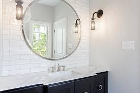 round mirror with black bath vanity