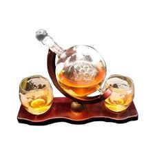 set with 2 etched globe whisky glasses