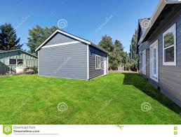 Blue Siding House With Matching Detached Garage Stock Photo Image Of Garage Fence 76323668